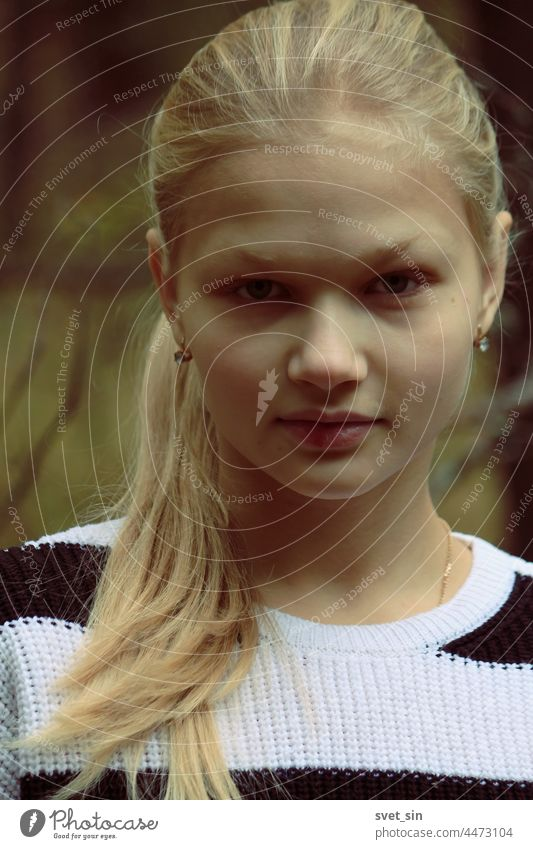 Portrait of a blonde girl in full face against the background of the autumn forest. portrait Autumn young outdoors looking teenager beauty natural hair lady