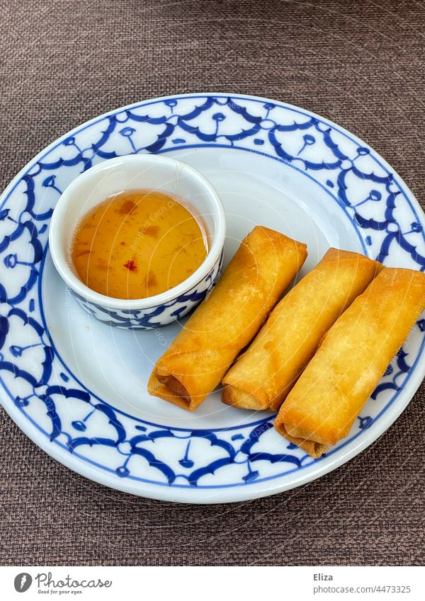 Three crispy spring rolls with sweet and sour sauce on a plate Spring roll Asian Crisp three Appetizer Delicious Plate