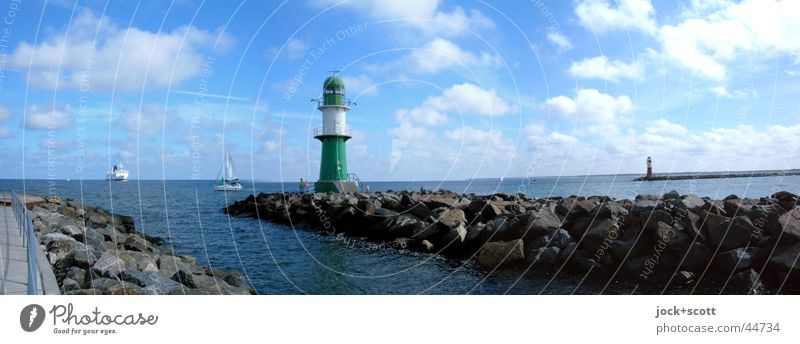 port entrance Cruise Summer Ocean Clouds Beautiful weather Baltic Sea Warnemünde Port City Harbour Lighthouse Ferry Sailboat Watercraft Stone Observe Driving