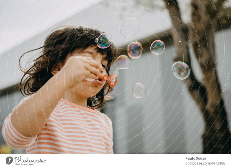 Child playing with soap bubbles Girl 1 - 3 years Caucasian Playing Soap bubble Happiness Colour photo Infancy Exterior shot Human being Joy Day Happy having fun