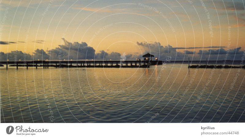 Calm before the storm Ocean Clouds Sunset Footbridge Maldives Umbrella Water