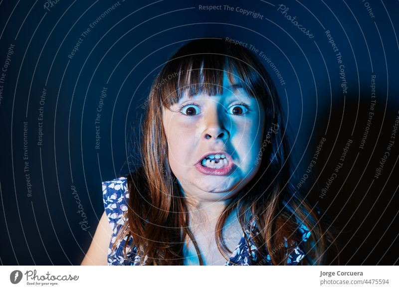 5-year-old Caucasian girl scared on halloween child abuse kid nightmares 4-5 years nervous childhood pretty shock back away face fear panic dream funny