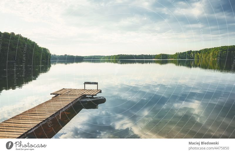 Wooden pier at a calm lake, Poland. nature water sky horizon reflection scenic peaceful beautiful landscape day still relax Lipie Dlugie nobody Europe
