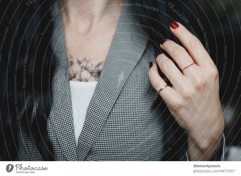 woman Upper body décolleté Hand Nail polish Rings Red Black Black-haired Tattoo Tattooed black-and-white Business Blazer Elegant Reliability Modern Style