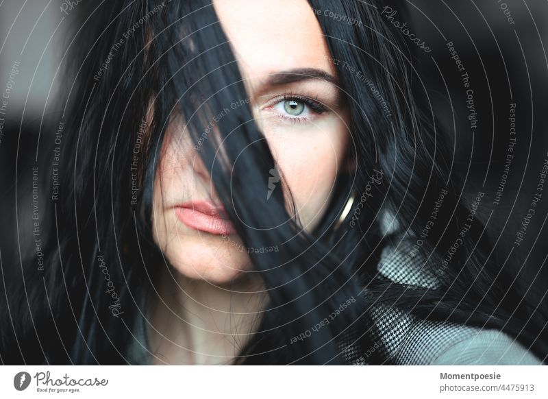 woman Black-haired green eye green eyes Eyes Observe Mysterious mystery Lips wisp Strand of hair Woman Face Hair and hairstyles portrait pretty Feminine