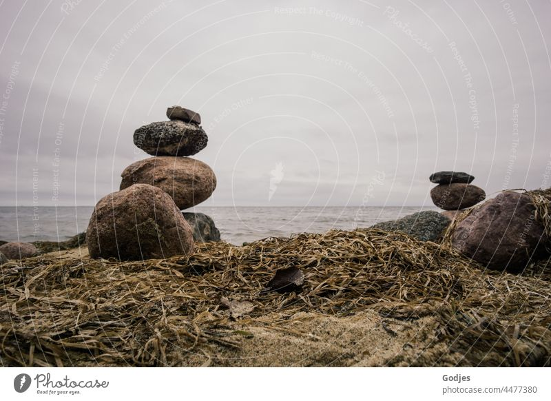 Stone towers on the beach of the Baltic Sea Stone Towers spires stone pyramid stones Water Bodden Sky Clouds coast Nature Beach Exterior shot Blue Tourism Waves