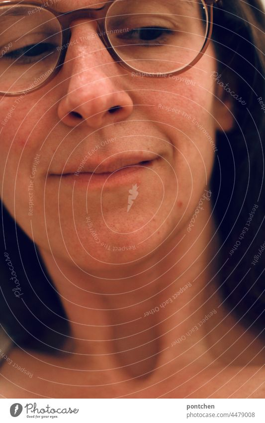 a woman with glasses directs her gaze sceptically downwards skepticism Looking Woman Eyeglasses look Face critical Neck thoughts
