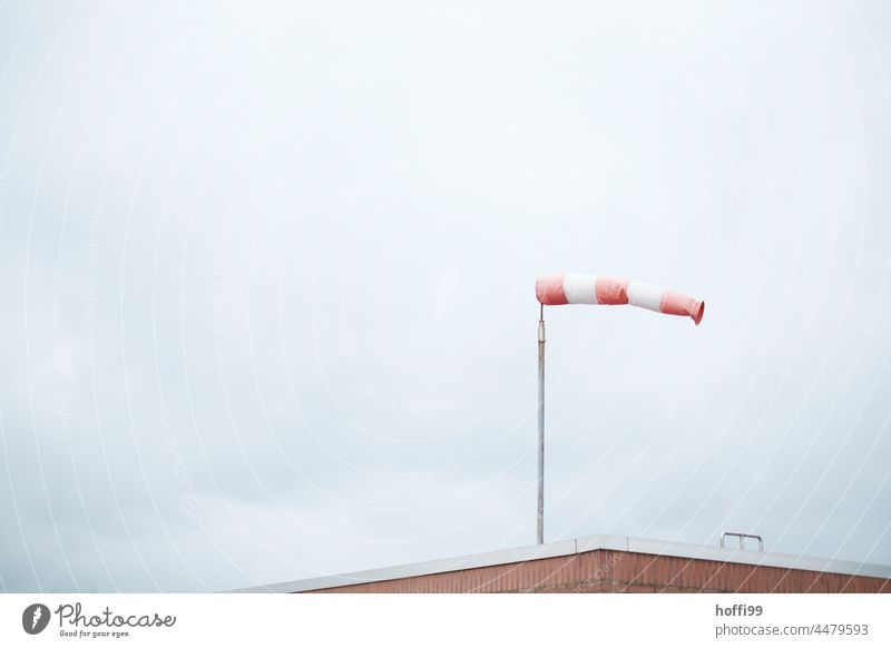 filled windsock - it blows hard from the west Windsock West West wind Autumn Autumn storms Gale Red Sky Clouds Weather Nature Air speed meter Gray Landscape