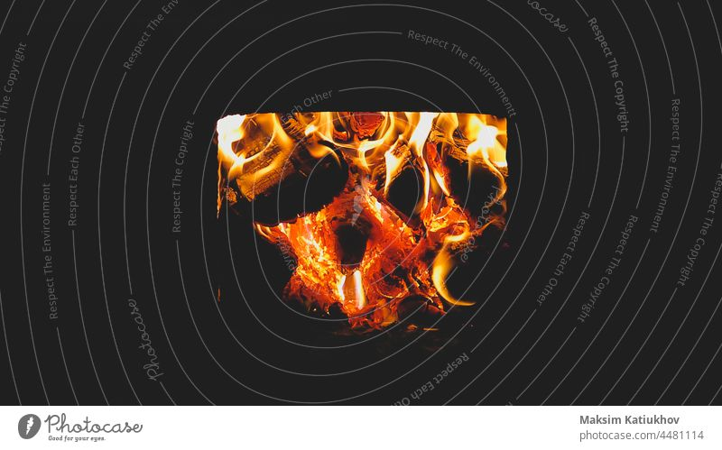 Burning firewood in the stove. flame in the fireplace burn bonfire warm yellow light red temperature background fuel black log blaze bright burnt campfire
