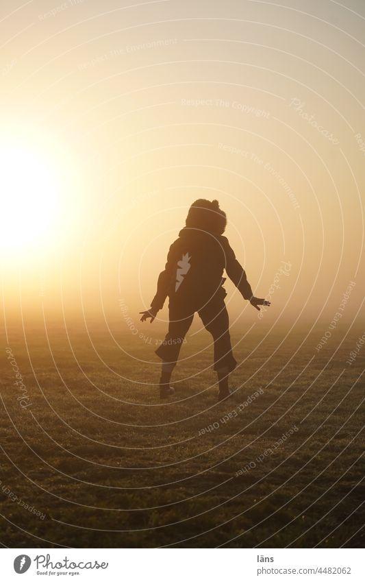 UT Teufelsmoor l Sun Child Human being Sunrise devil's mire Earth's gravity Gravity landing jump Back-light Dawn Colour photo Bog Fog Copy Space bottom
