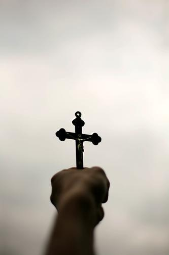 God left you alone? / howl! Lifestyle Human being Woman Adults Man Youth (Young adults) Hand 1 Christian cross Crucifix To hold on Dark Above Emotions