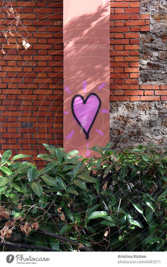 graffiti heart on the wall above a hedge Heart sweetheart Graffiti Love street art In love Romance romantic Wall (building) Wall (barrier) bricks Bricks Facade