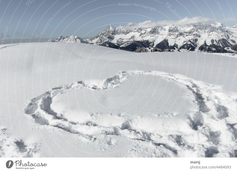 Love affirmation in winter, stepped in the snow. Mountain world in the background Infatuation Romance romantic Heart Heart-shaped tracks in the snow Ski tour