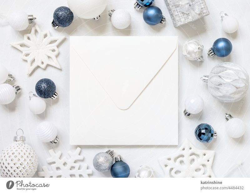 Blank square envelope with Christmas decorations top view, Mockup christmas mockup present blue silver New year white bauble paper ornament winter holiday tag