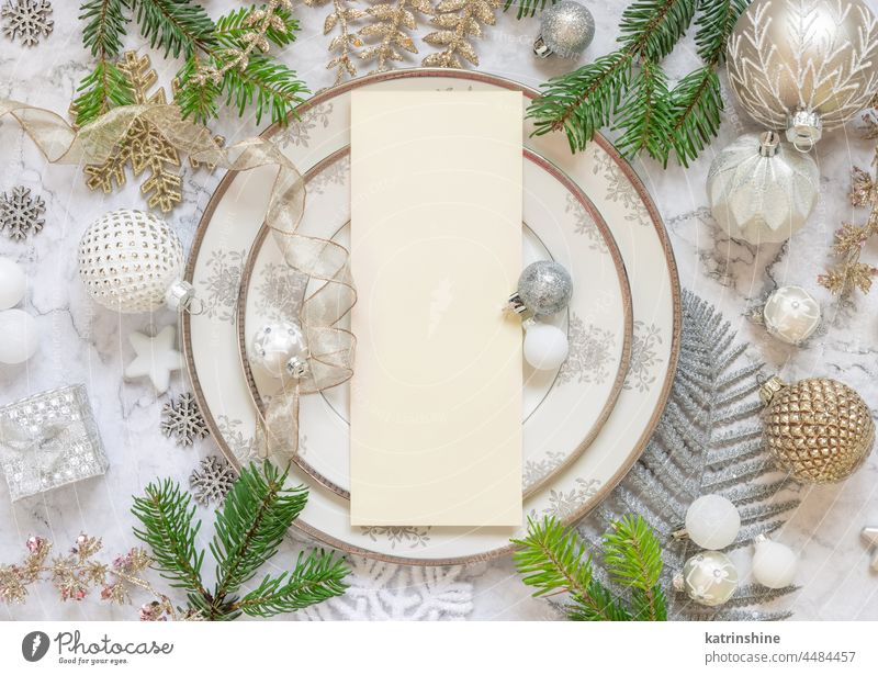 Festive table setting of with fir tree branches and Christmas decorations. Mockup christmas menu mockup card ornaments holiday new year celebration copy space