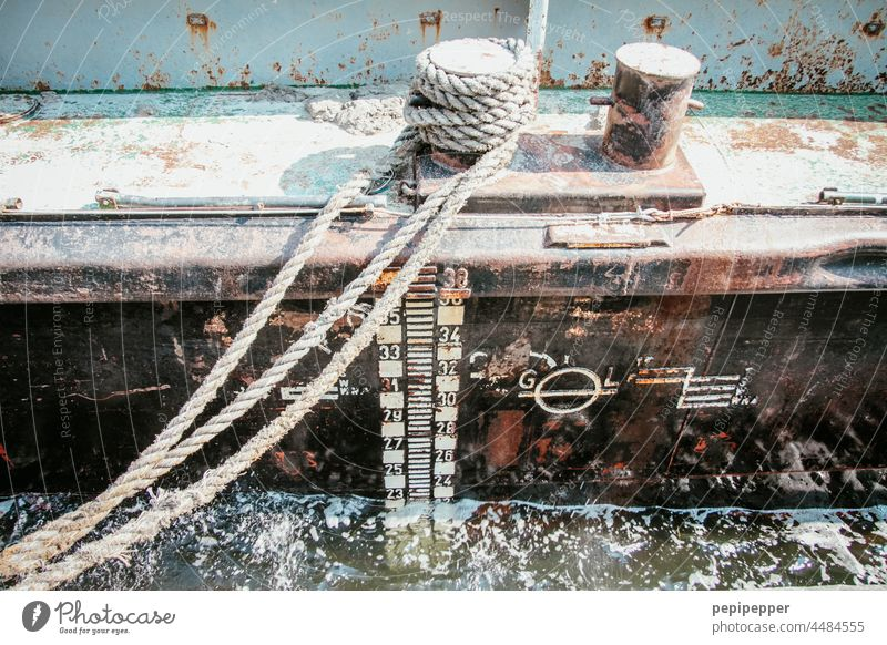 Always a hand's breadth of water under the keel - old, rusty ship lying in the harbour and fastened with an old rope Wake Keel Water Harbour Exterior shot