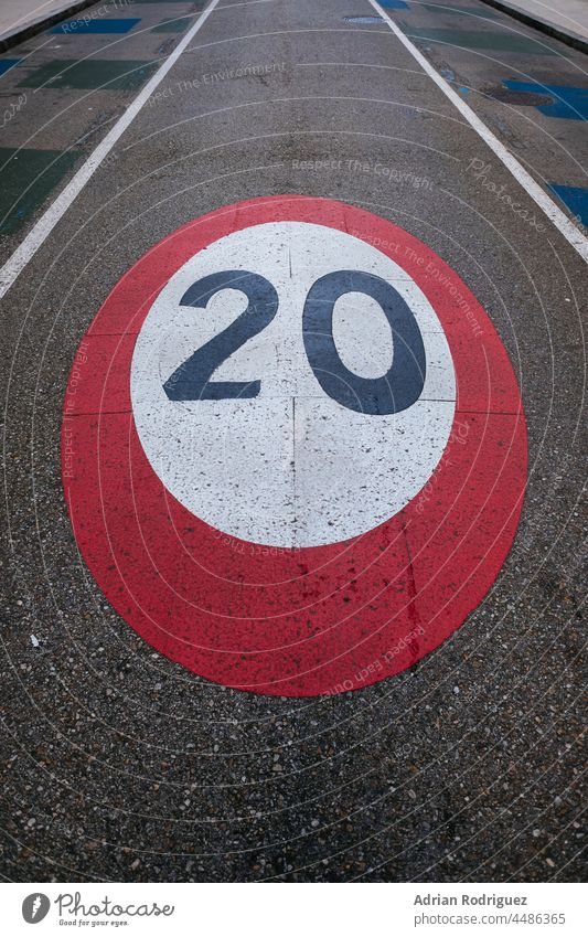 Speed limit sign painted on the road circles direction drive information law lines number path round safety slow speed traffic transport transportation warning