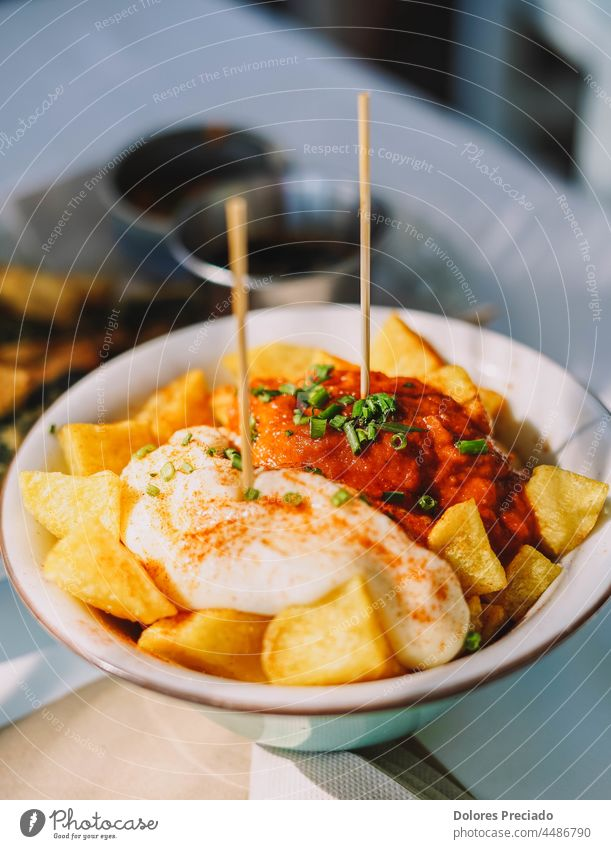 Tipical spanish tapa of potatos and spicy sauce appetizer background baked barbecue bravas brave chili chilli cooking crispy cube cuisine culture delicious