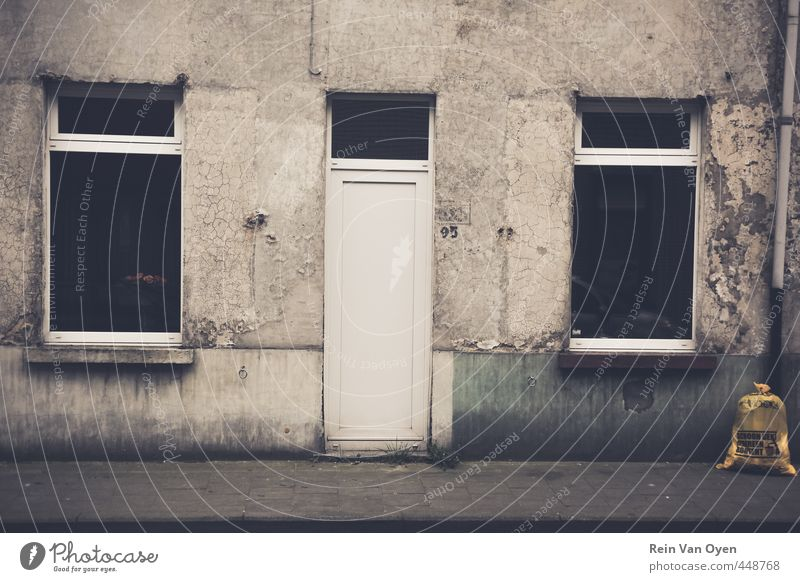 Dirty facade Village Small Town House (Residential Structure) Wall (barrier) Wall (building) Facade Window Door Bell Old Dark Gray Subdued colour Exterior shot