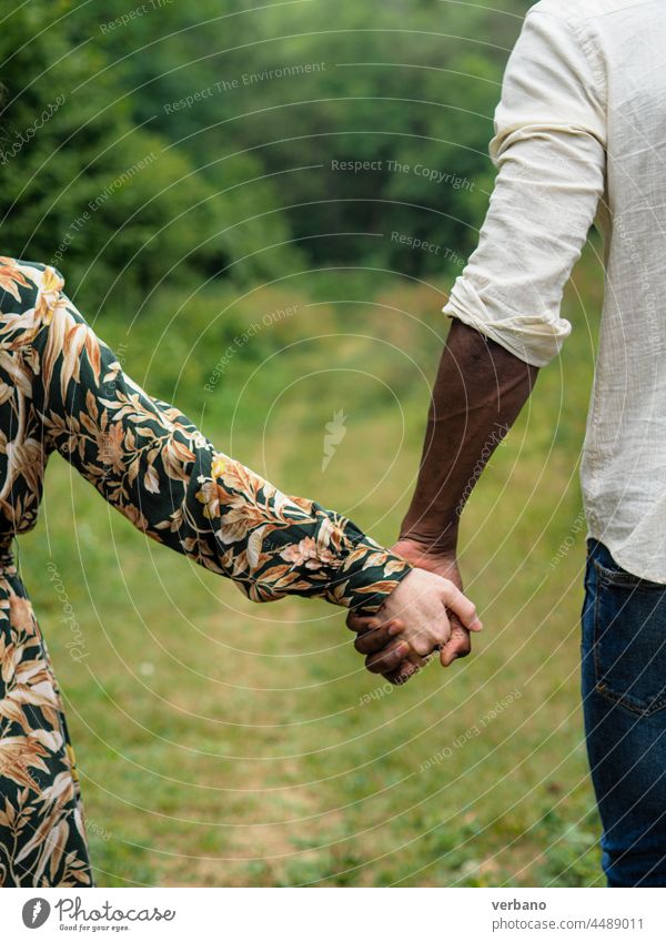 interracial couple holding hands diversity concept afro caucasian diverse love family new order culture ethnics woman people smiling outdoors smile happiness