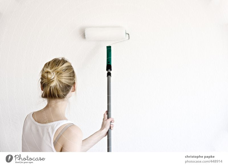 Blonde woman painting wall with roller Redecorate Moving (to change residence) Painting (action, work) string part Home improvement Flat (apartment) Wallpaper