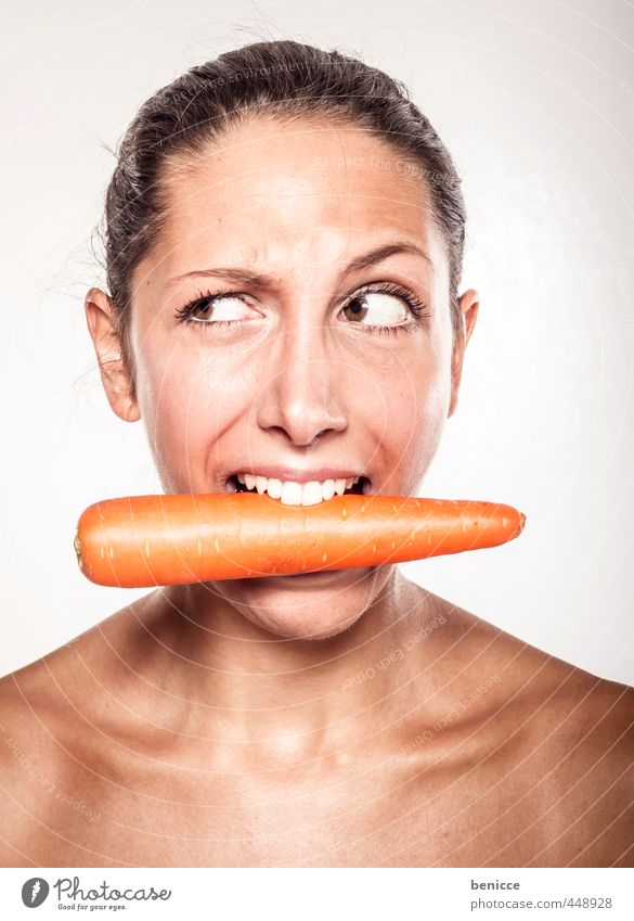 vegan Woman Carrot Mouth Grimace Face Portrait photograph Vegetarian diet Human being Looking Bright background Bite Teeth Skeptical Vegan diet Young woman