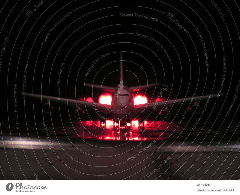 Airplane Aviation Industrial Photography Airport Night Airplane landing Traffic light Departure Pilot Jet Runway Cargo Passenger plane Airmail Landing gear Cargo hold