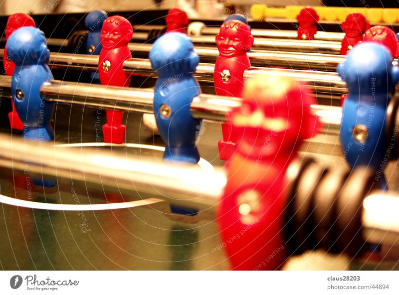 foosball devil Red Table soccer Macro (Extreme close-up) Close-up Sports Dynamics Blue Depth of field Rod Piece Playing field Colour photo
