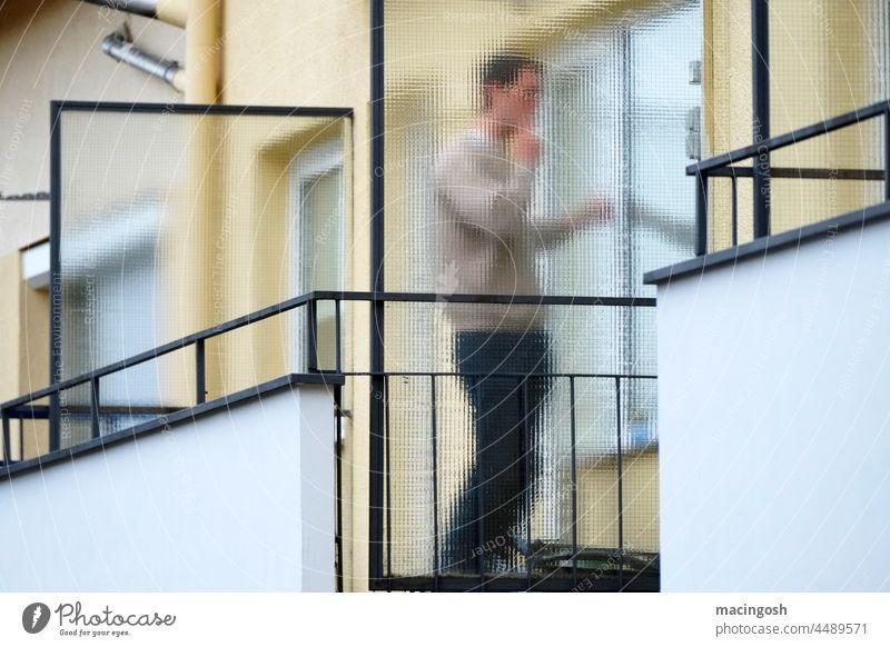 Anonymous balcony smoker Balcony Exterior shot Smoking Smoky Cigarette Human being Only one man more adult Smoke Cigarette smoke Addiction Nicotine