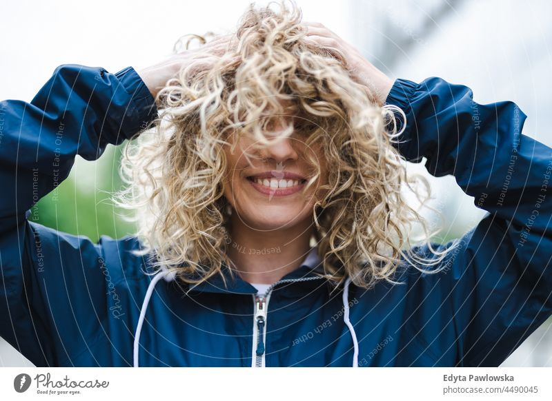 Portrait of laughing young woman outdoors Warsaw day fun curls hairstyle summer happiness tourist beauty smiling cheerful real people city life blond hair 20s