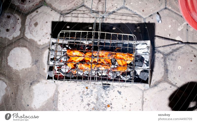 Chicken wings on barbecue grill grilled meat food cooking outdoor chicken wing copy space coal freshness healthy eating ready-to-eat appetizer chicken meat