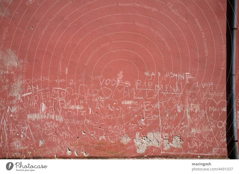 Scratched graffiti on a dark red wall Graffiti Graffito Red Wall (building) Shadow Downpipe scratched inscriptions Inscription Youth culture teen