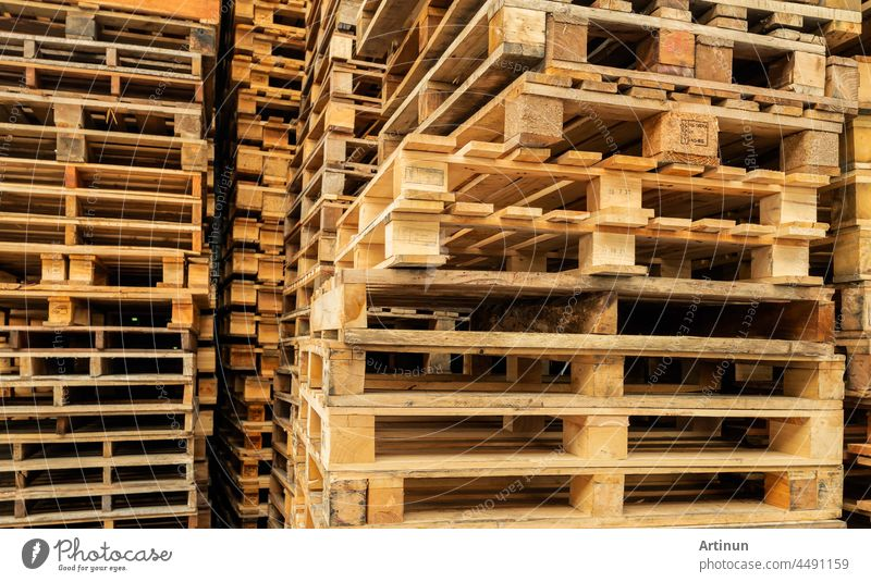 Stack of wooden pallet. Industrial wood pallet at factory warehouse. Cargo and shipping concept. Sustainability of supply chains. Eco-friendly nature and sustainable properties. Renewable wood pallet.