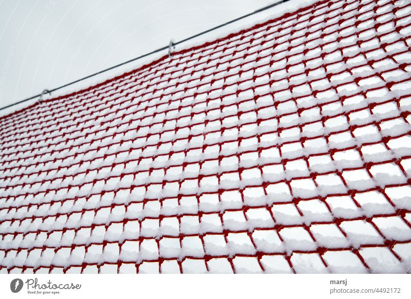 Safety net in red. Decorated with fresh snow. safety net safety precaution Red Net Slope safety Structures and shapes Network