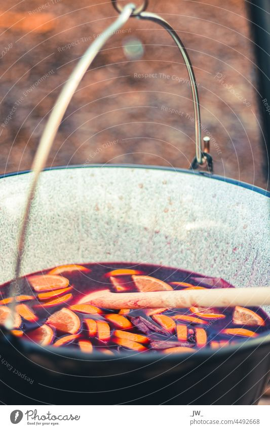 Mulled wine with orange pieces in a large pot over the campfire Punch Pot Christmas & Advent Colour photo Winter Hot drink Close-up Beverage