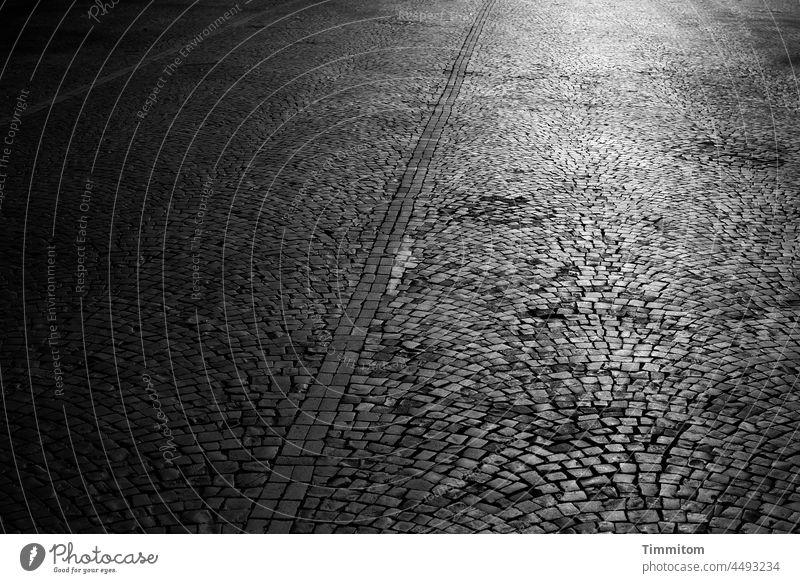 Square with cobblestones Places paving Paving stone lines Large light and dark Light Shadow Sunlight Exterior shot Deserted Dark Gray Black Black & white photo