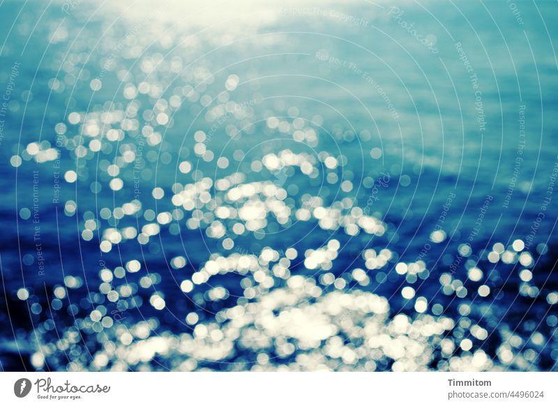North Sea with points of light Point of light Water Ocean Light Sunlight Blue blurriness Waves Glittering Nature Deserted Exterior shot Denmark