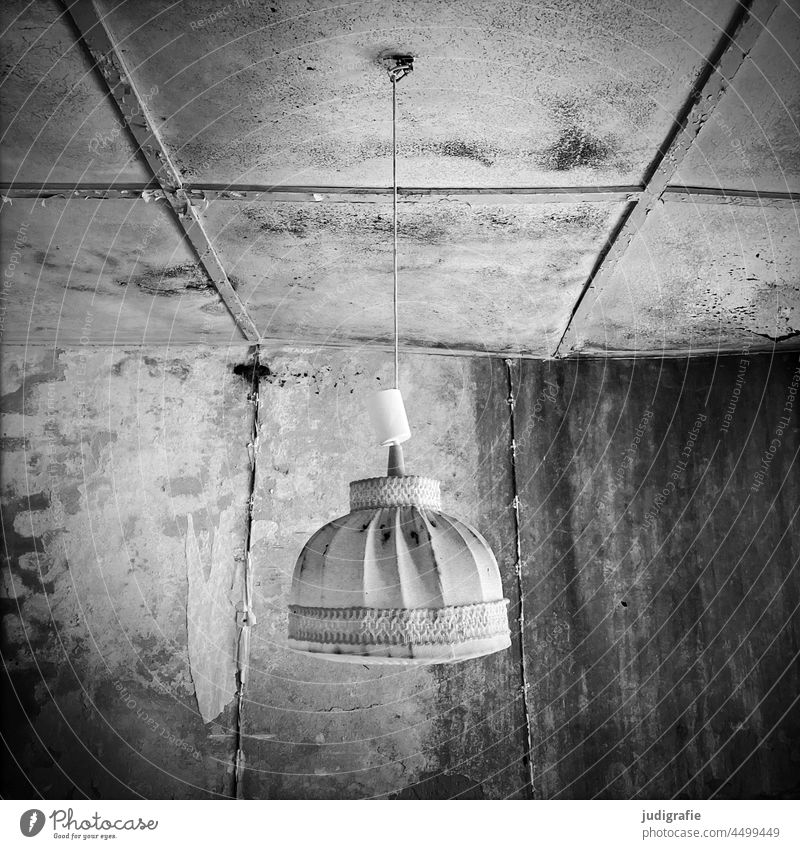 A lamp hangs almost intact in a bungalow that has been empty for a very long time. Lamp Lampshade Ruin Old dilapidated Time travel Mold Gray (horse)