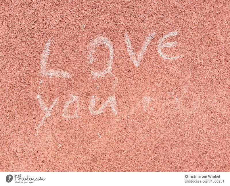 ' LOVE you ' is written in white letters on a pink plastered wall Love you Declaration of love With love Infatuation Emotions Display of affection Romance