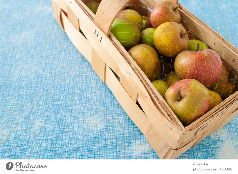 Boskop Apples in a Basket on blue background - thanksgiving Nature Blue Joy Yellow Healthy Happy Wood Food Brown Fruit Gold Nutrition Retro Delicious Harvest