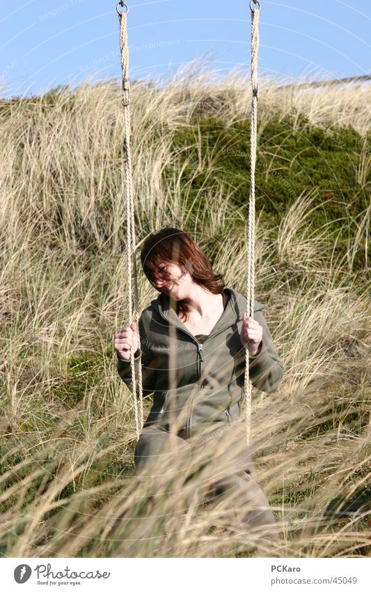 Woman Vacation & Travel Calm Meadow Grass Wind Romance Beach dune Swing Sylt Straw