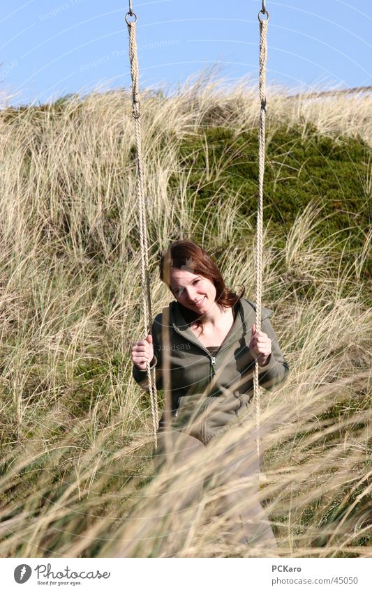 Woman Vacation & Travel Calm Meadow Grass Romance Beach dune Swing Sylt Straw