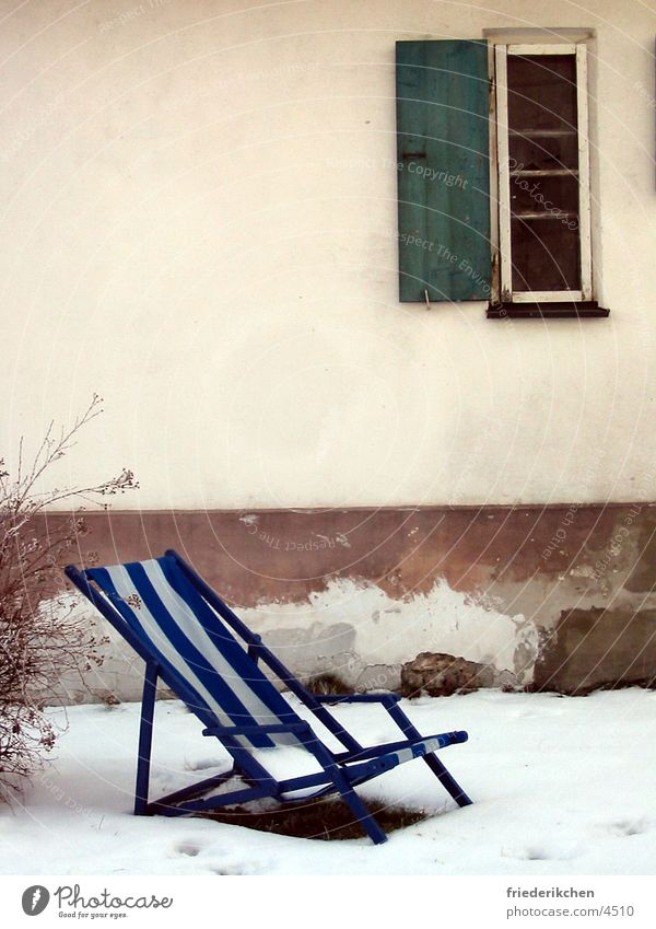 Deckchair in the snow I Snow Window Day Winter Shutter House (Residential Structure) Wall (building) Blue Stripe Thaw Weather Moody Snowscape Garden Park