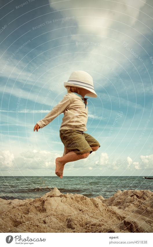 up and away... Joy Leisure and hobbies Playing Vacation & Travel Freedom Summer Summer vacation Beach Ocean Child Toddler 1 Human being Hat Movement Flying Jump