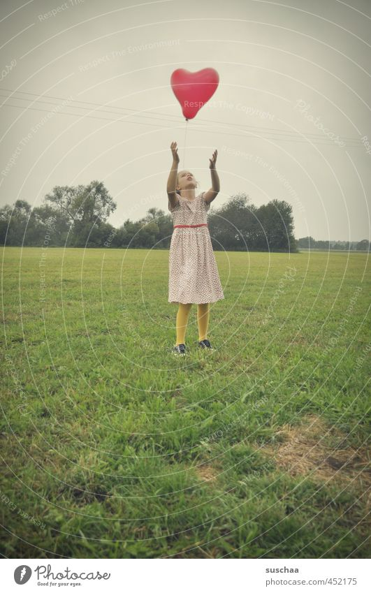 hearts flieeeeeg Child Girl young girl feminine Infancy Body Arm 8 - 13 years Environment Nature Landscape Sky Summer Climate Grass Bushes Uniqueness Green Red