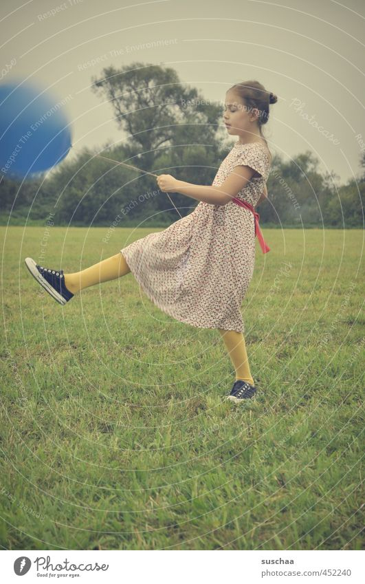 the blue balloon .. Child Girl Dress Arm Legs Feet Hand Exterior shot Playing Meadow Grass Balloon Retro young girl Infancy playfulness Family party Funny drama