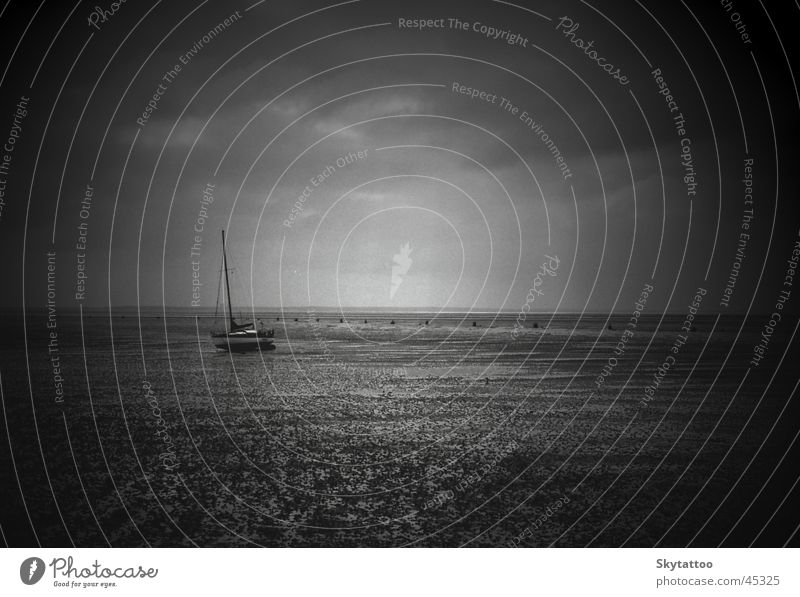 solitariness Watercraft Sailboat Ocean Black White Gray Calm Mud flats North Sea Sand lonely Empty Free