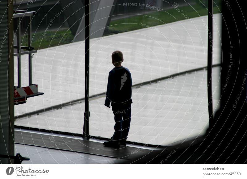 Human being Child Man Dark Boy (child) Window Bright Airport Warehouse