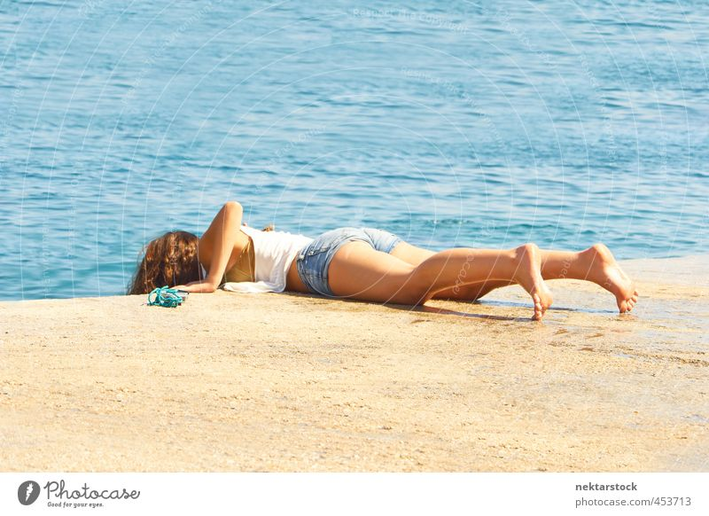girl at water Vacation & Travel Summer Summer vacation Sun Sunbathing Ocean Feminine Young woman Youth (Young adults) Skin Back Bottom Legs Feet 1 Human being