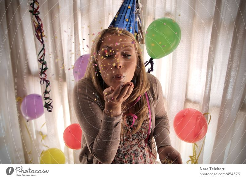 Make a wish! Party Feasts & Celebrations Woman Confetti Multicoloured Balloon Decoration Curtain Surprise Blow Birthday Face Desire Light Human being Girl Hat